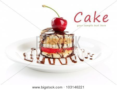 Tasty biscuit cake with chocolate and berry on plate, isolated on white