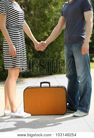 Young couple with vintage suitcase outdoors