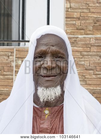 Eighty-year-old African man smiling in the street