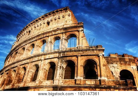 Colosseum in Rome, Italy. Symbol of the ancient city. Amphitheatre over deep blue sky