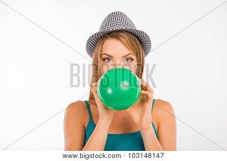 Cute Girl Inflating Green Balloon
