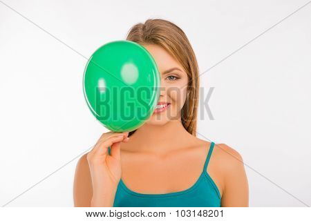 Happy Cute Girl Hiding Her Face Behind Green Balloon