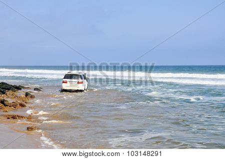 Adventurous Driving Along the Beach