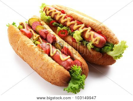 A pair of fresh hot dogs isolated on white