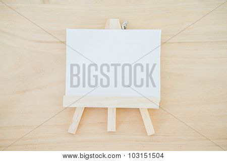 White Canvas Art Board On Wood Texture Background