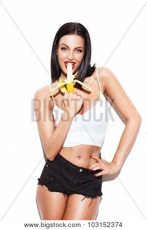 Sexy Brunette Woman Eating Banana
