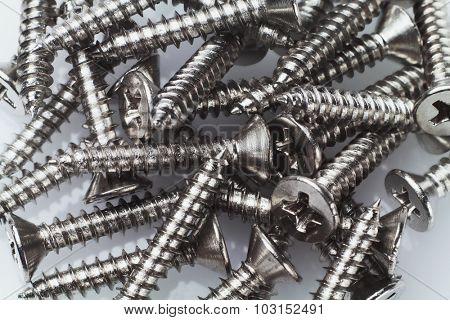 Pile of Metal Screws Background