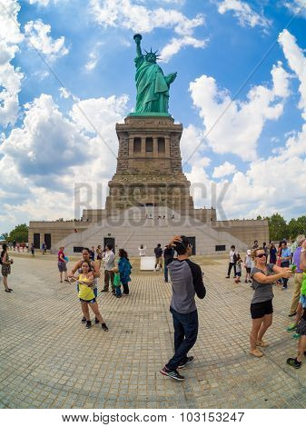 NEW YORK,USA - AUGUST 16,2015 : Tourists at the Statue of Liberty in New York City