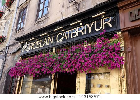 LJUBLJANA, SLOVENIA - JUNE 30: Beautiful flowers over the entrance to the store porcelain in Ljubljana, Slovenia on June 30, 2015