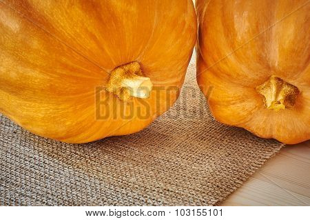 Autumn pumpkins on a wooden backround in a rustic style