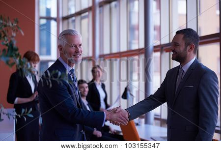 business partners, partnership concept with two businessman handshake