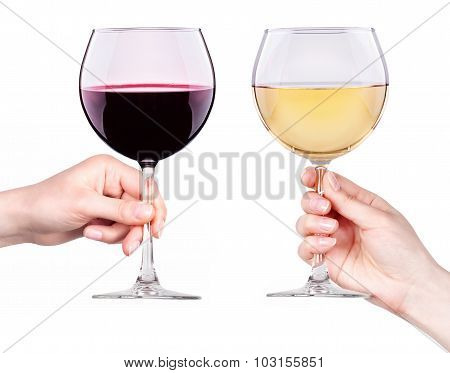 Glasses of red and white wine in hand isolated
