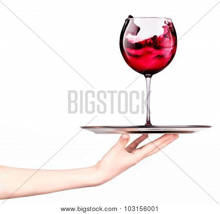 Waitresses holding tray with glass of red wine