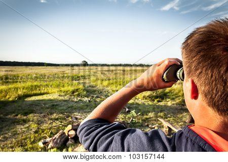 Child exploring field area