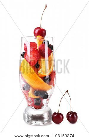 Fresh fruits salad in glass isolated on white