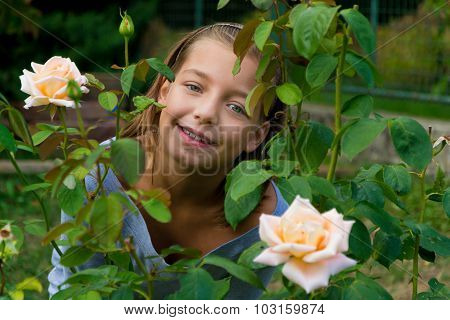 Little Cute Gypsy Child Girl Between Roses Happy Smiling Pretty