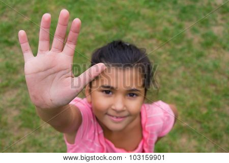 Gypsy Child Offering Hand For High Five Against Racism, Shot From Above Perspective