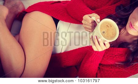 Autumn Woman Holds Mug With Coffee Sitting On Sofa