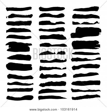 Large Set Of Thick Black Paint Strokes Isolated On White Background