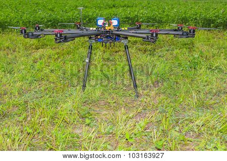 Multicopter standing on the ground in the field