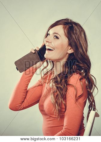 Happy Young Woman Talking On Mobile Phone.
