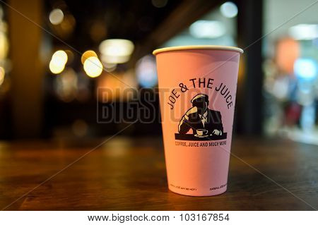 NICE, FRANCE - AUGUST 15, 2015: close up shot of Joe and the Juice cafe cup. Joe and the Juice's biggest cup is pink color.