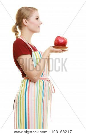 Housewife In Kitchen Apron Offering Apple Healthy Fruit