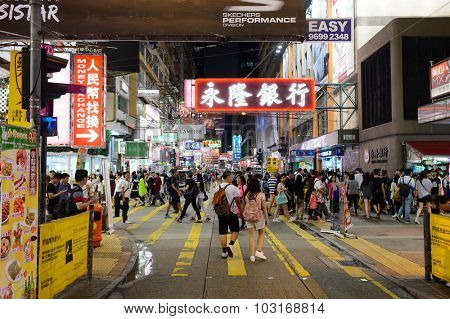 HONG KONG - JUNE 01, 2015: Mongkok area. Mong Kok is characterized by a mixture of old and new multi-story buildings, with shops, restaurants at street level and commercial or residential units above.