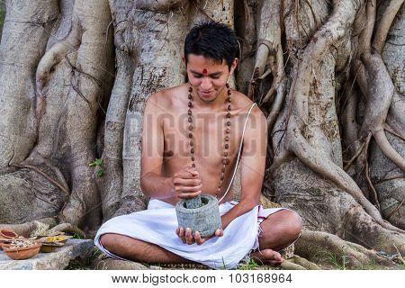 Ayurvedic Doctor Making Medicine