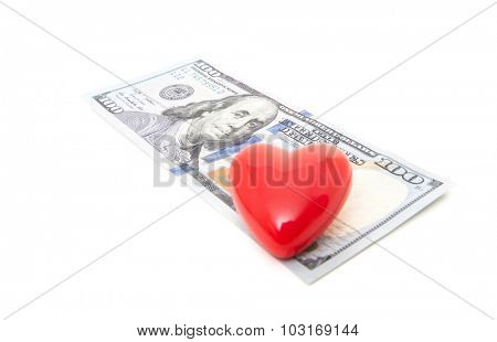 Red heart on hundred dollar note