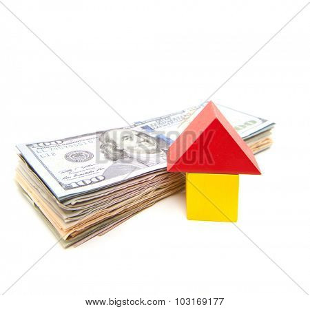 Stylized home next to pile of dollar notes. All on white background.
