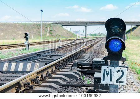 blue semaphore on railroad