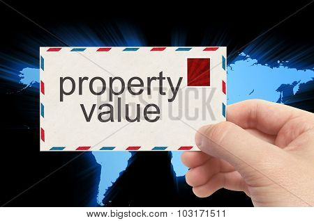 Hand Holding Envelope With Property Value Word On World Background