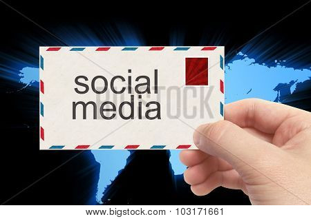 Hand Holding Envelope With Social Media Word On World Background