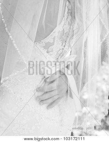 black and white image of groom's hand