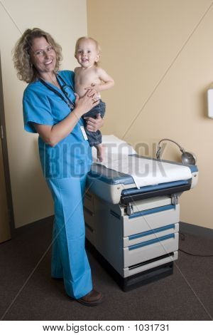 Female Medical Professional Standing With Child