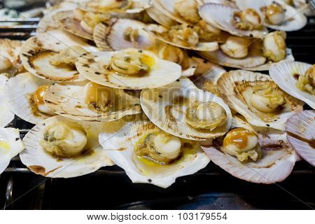 Grilled Scallops Topped With Butter, Garlic And Parsley.