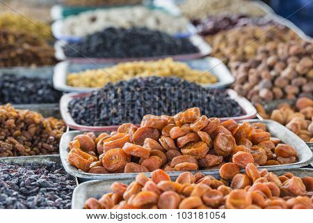 Dry Fruits And Spices Like Cashews, Raisins, Cloves, Anise, Etc. On Display For Sale In A Bazaar In
