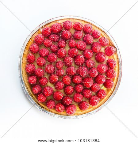 Tart with raspberries on a white background. top view