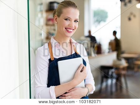 Proud young female cafe owner