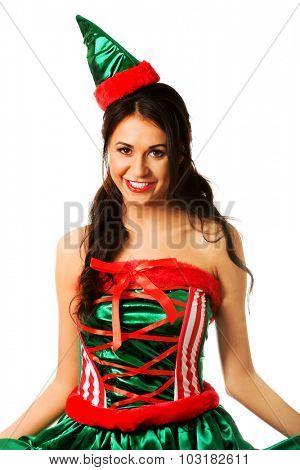 Woman wearing elf clothes smiling to the camera