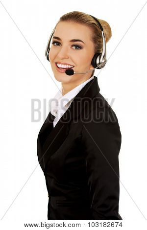 Happy young businesswoman with headset.
