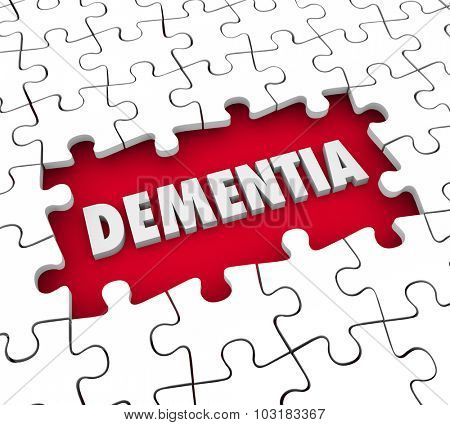 Dementia word in a hole with puzzle pieces to illustrate aging, memory loss, mind or brain degeneration and medical treatment for the condition
