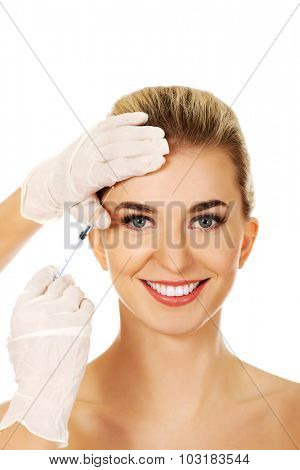 Young woman has a cosmetic botox facial injection