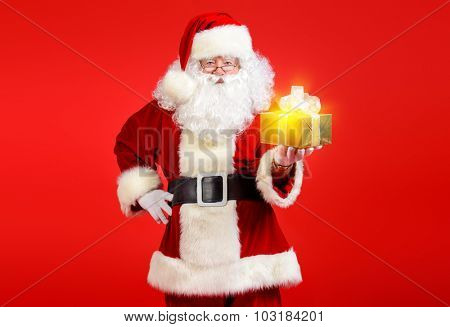 Portrait of Santa Claus with a gift. Christmas.