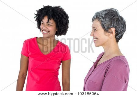 Cheerful young woman with mother against white background