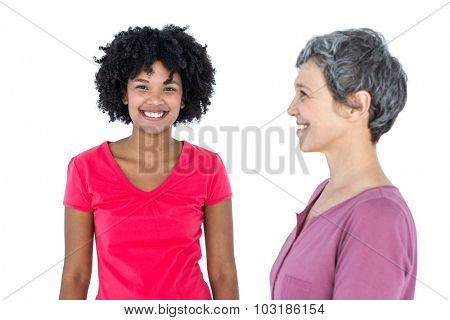 Portrait of happy young woman with mother standing in foreground