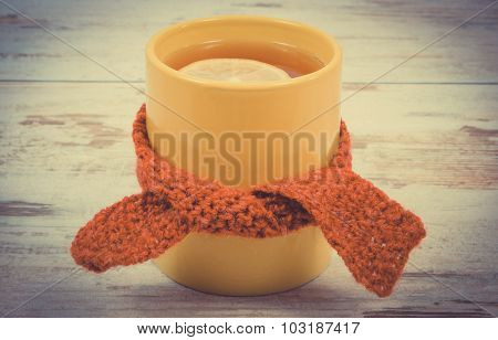 Vintage Photo, Cup Of Hot Tea With Lemon Wrapped Woolen Scarf