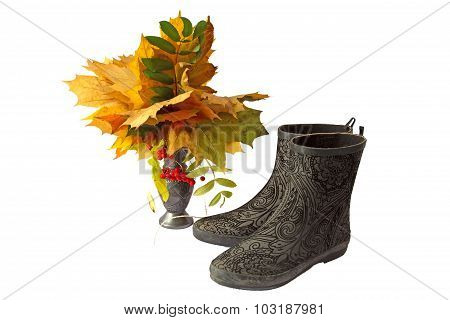 A Bouquet Of Autumn Leaves And Boots