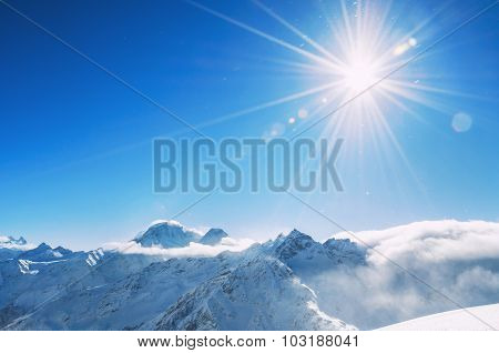 Winter Snow-covered Mountains At Sunny Day